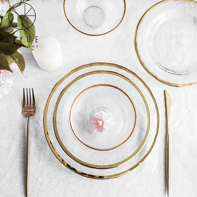 Alibaba.com / Gold rim glass charger plates dinnerware set fruit service glass dinner plate for wedding banquet