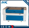 Jinan laser engraving machine price for glass sheet plastic wood MDF Furniture decoration fabric 600*900mm