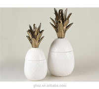 made in china white and bronze-colored ceramic pineapple cookie jar