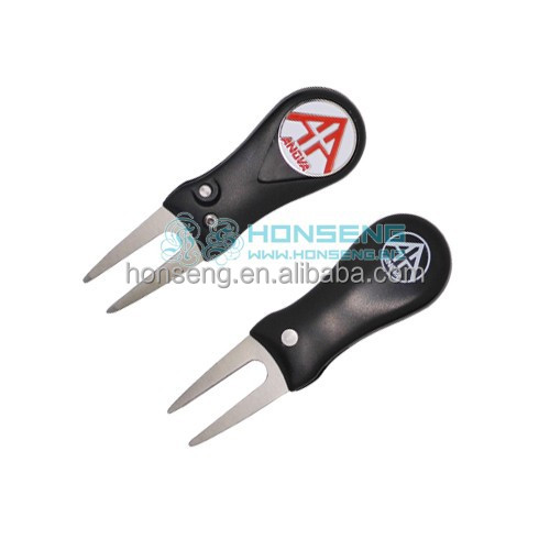 Black plastic golf divot tool with ball marker