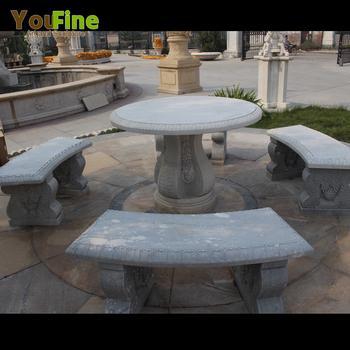 屋外の装飾ラウンド大理石のダイニングテーブルとベンチ