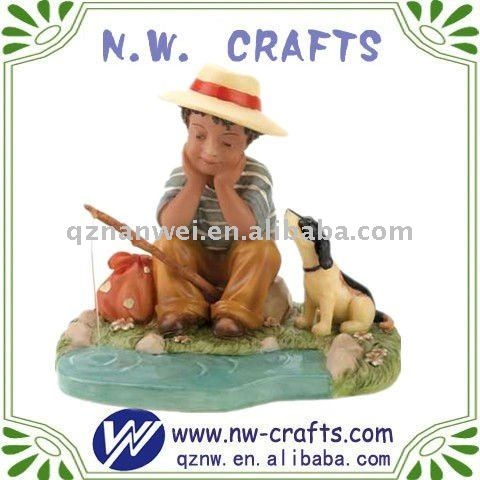 The fisherman boy with dog figurine