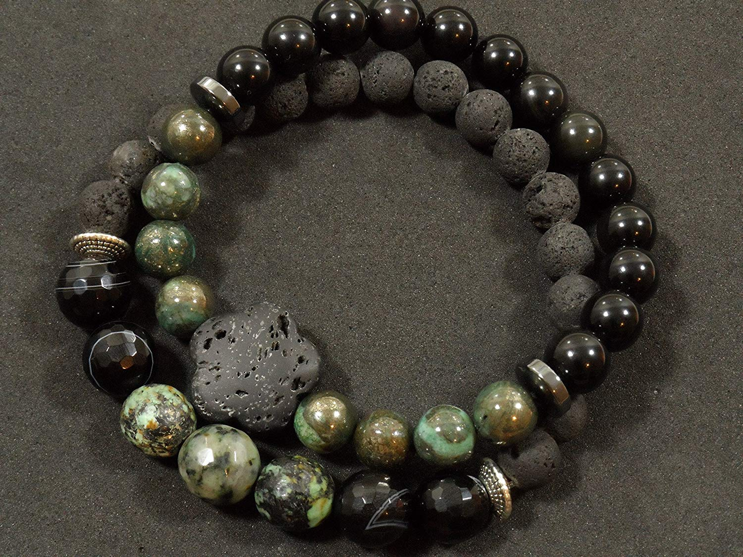 2 Bracelet Stacked Set: 10mm Faceted Moss Agate, 10mm Faceted Onyx, 8mm Lava with Silver Toned Accents; Large Lava focus stone, 8mm Pyrite, 8mm Onyx, with Hematite Accents.