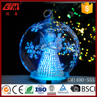 Glass ball with angel figurine and led light inside hanging glass ball