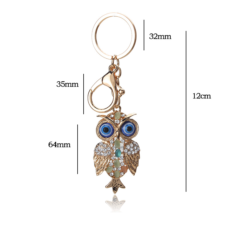 Alibaba gold alloy blue evil eye owl keychain fashionable metal blue eye <strong>key</strong> for woman man keychain