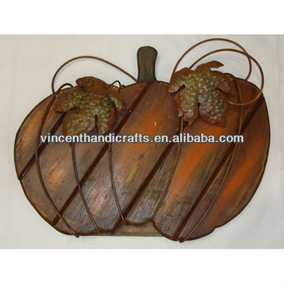 Rustic antique wooden pumpkin with metal rusty leaves ornaments
