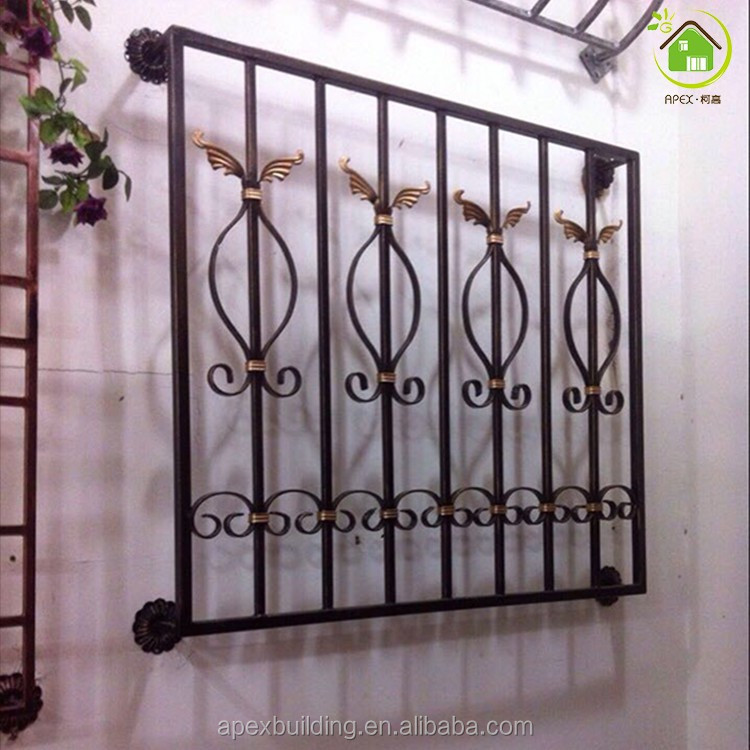 Beautiful decorative wrought iron windows grill design for Iron window design house