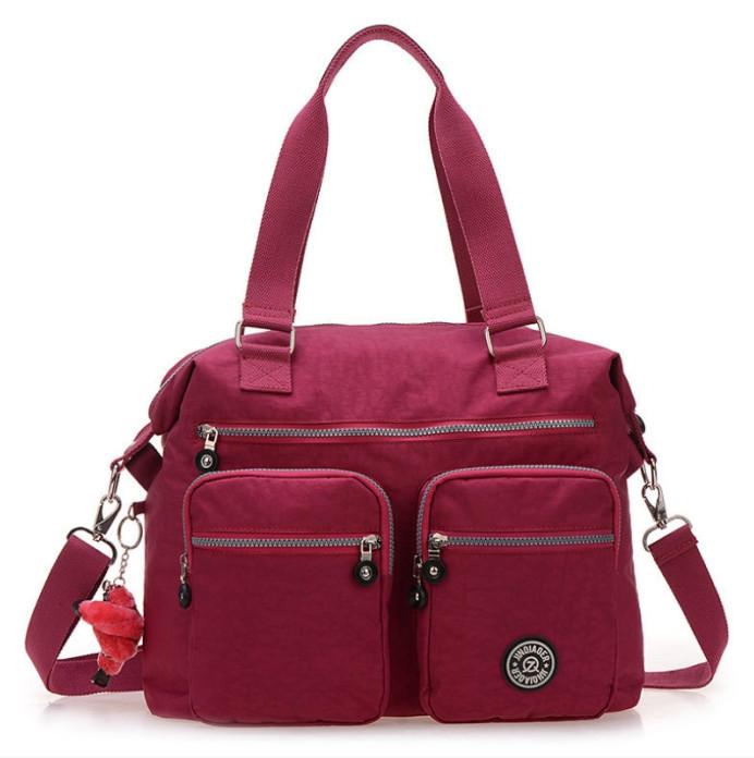 Get Quotations · 10colors Big Capacity Waterproof Women Nylon Handbag  Shoulder Messenger Bags Brand JinQiaoEr Monkey Kiple Style Bag a4ceaf6f1f