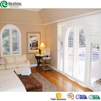 Basswood clear view arched plantation shutters