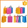 Screen printing drawstring small colored paper bags with handles