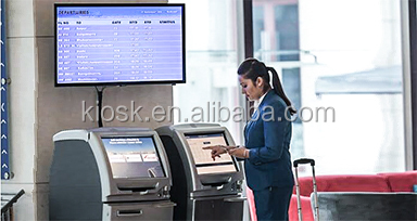 Self-service check-in touch screen kiosk for printing boarding cards in airport