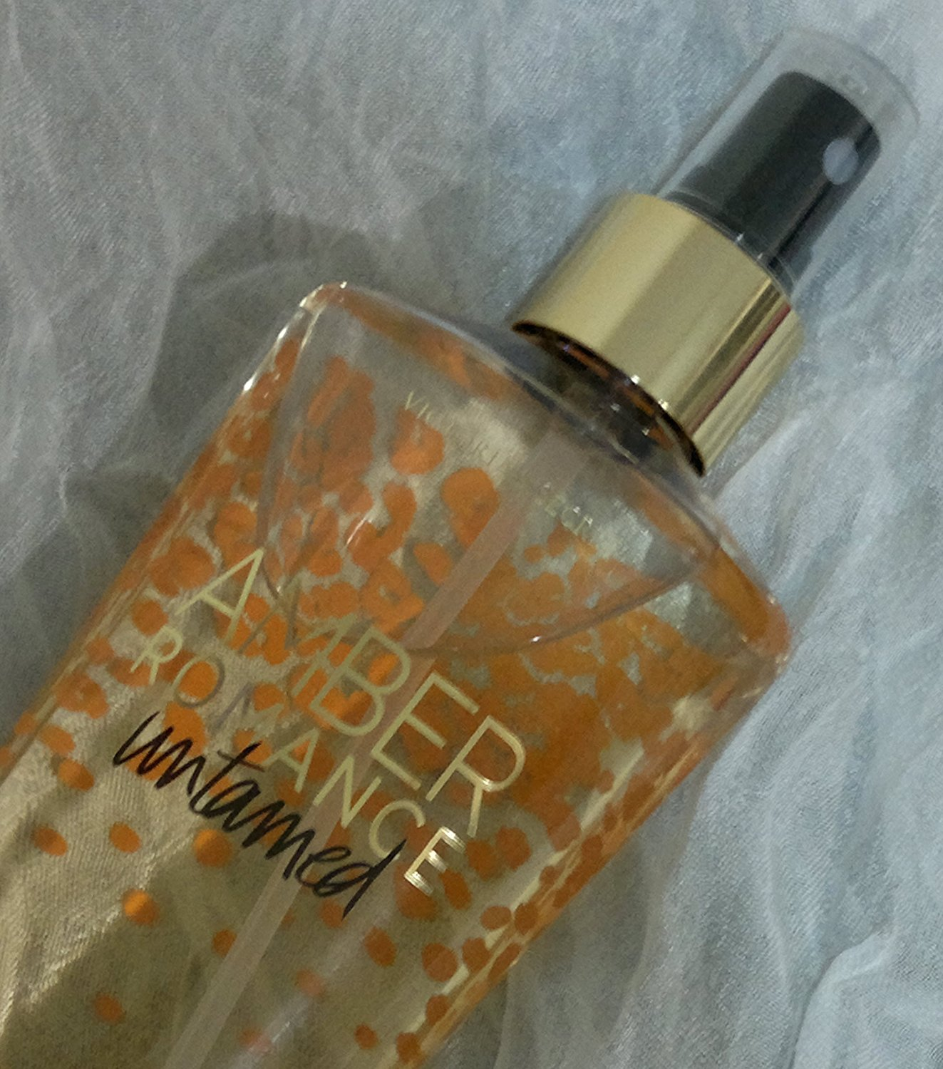 c59ab70569a Get Quotations · Amber Romance Fragrance Mist Untamed Vs Fantasis (New  Look) by Victoria s Secret