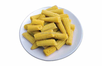 Canned baby corn cut in glass jar