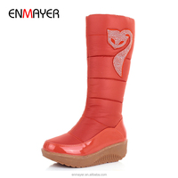 Best selling china factory cheap women warm furry comfortable wedge snow boots