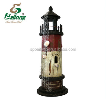 wood lighthouse with shell and fishing net