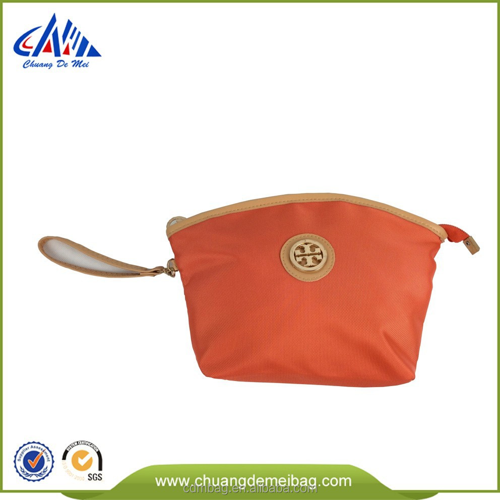 2015 new product polyester orange hand bag with golden nylon zipper and metal logo and one small pocket inside