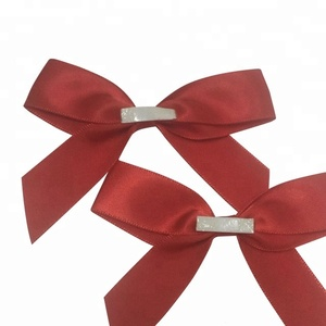 Red satin ribbon bow with self adhesive tape for gift