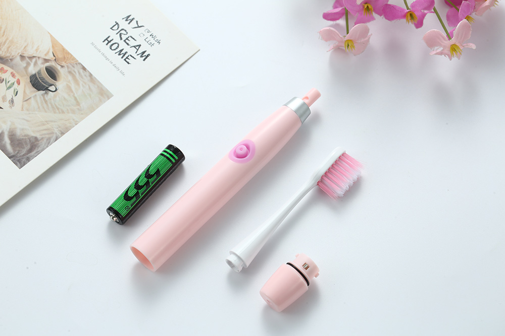 Deep clean teeth brushing small size AAA battery powered home/travel use pink electric toothbrush
