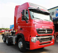 SINOTRUK HOWO T7H 6X2 440HP Euro4 MAN Engine Tractor Head Truck with Rear Axle Lifting