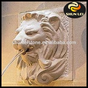 Hand carved stone wall sculpture