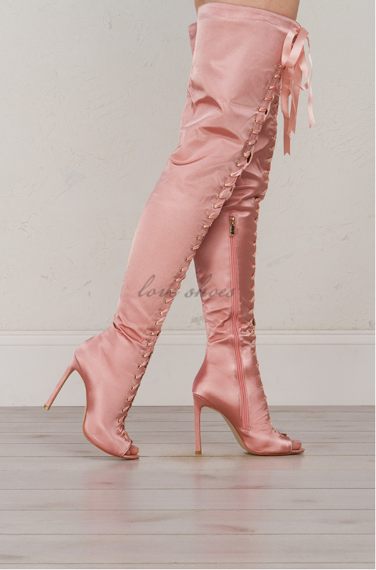 9d6869f60792a ... the heat with a thigh high satin physique, dramatic lace up front, a  clean tapered heel and a saucy peep toe. Zip these heeled boots up and pair  with a ...