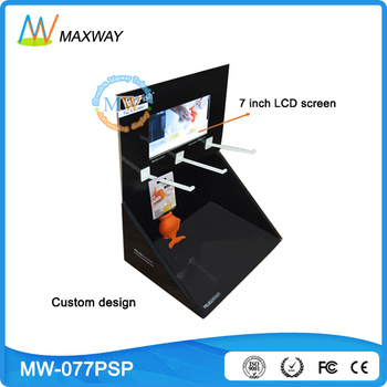 cardboard counter display with 7 inch LCD screen on top
