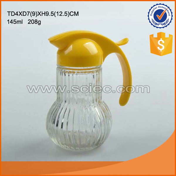 oil/vineger glass bottle with metal /plastic handle