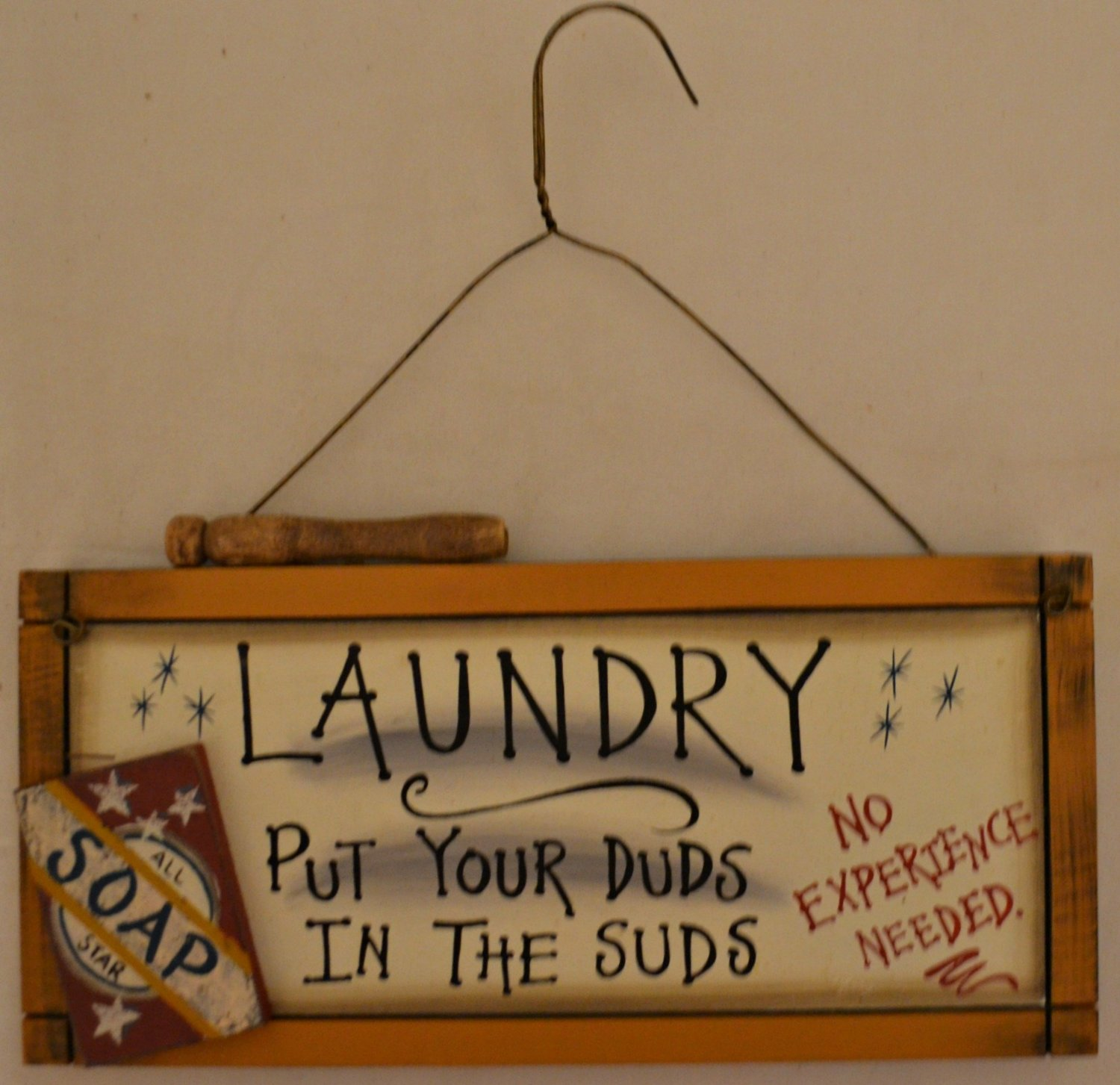 "Rustic Country Wood Plaque Sign Decoration with a Metal Hanger Shaped Wire for Hanging 12 x 6 x 1 Inches. Wooden Sign Saying ""Laundry Put Your Duds In The Suds No Experience Needed"" with Decoration All Star Soap, Clothespin, and Brown Border"