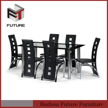 black lacquer painted metal dining table and chairs
