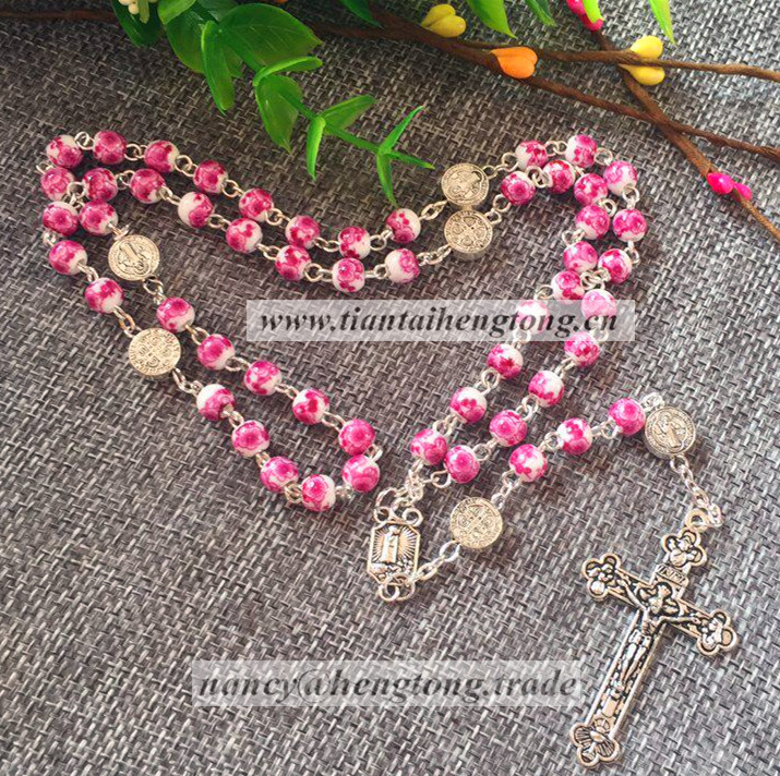 Ceramic Religious rosary necklace with pattern on white background beads and fatima center and benedic connector