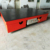 Rail mounted steel coil transfer cart