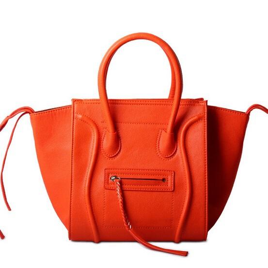 12e65d510c53 Get Quotations · 2015 New Arrival Top PU leather Women Smiley Bat Bags  Tassel Phantom Series Smiley Shoulder Bag
