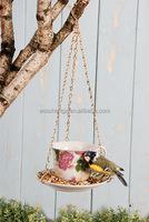 Hanging teacup ceramic bird feeder