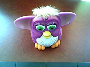 1998 Mcdonald's Tiger Electronics Furby Happy Meal Toy---purple Body Version, Yellow Hair Top, Green Eyes, White Belly, Pink Ears, Orange Feet, Brownish Backside---mfg. for Mcd. Corp. Copyright Furby 1998 and Trademark Tiger Electronics, Ltd.
