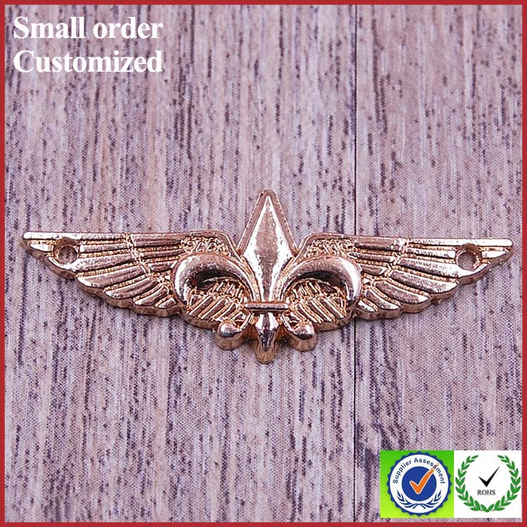 Indonesia gold wing shape metal badge sheet craft for dress clothing