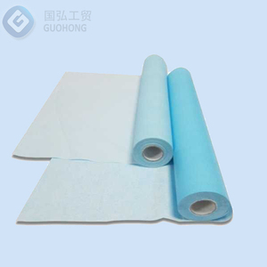 Perforated, embossed paper rolls for bed protection color blue