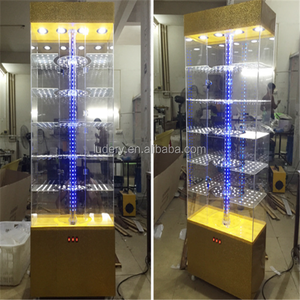 Luxury store floor standing Rotating Hexagonal glass display showcase/Tower showcase display/acrylic showcase design