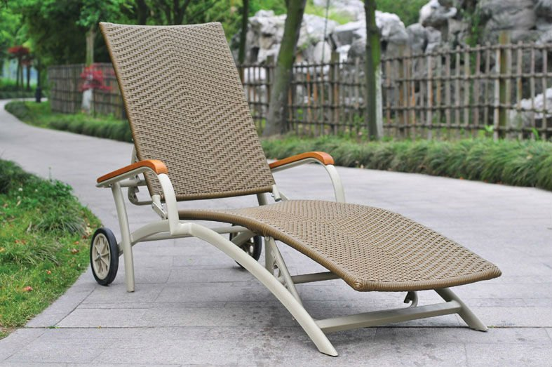 Weave wicker cane sun lounge with wood armrest and wheel
