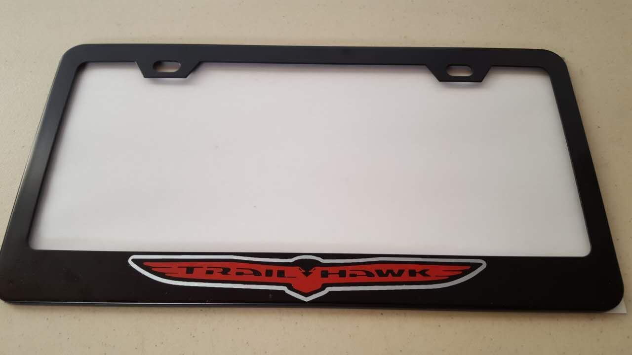 Jeep Trailhawk Red Vinyl Decal Cut on Black Metal License Frame with matching color screw caps