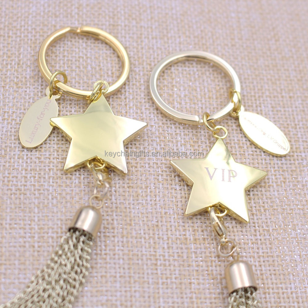 Custom promotion gifts shiny gold star tassel keychain with laser logo