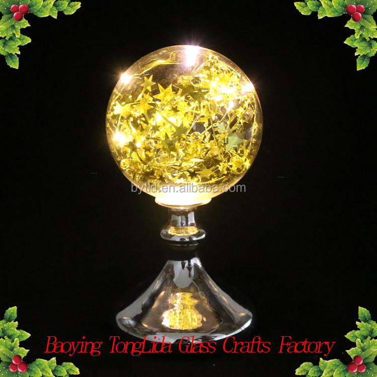 Clear led glass ball with gold star ornamnets