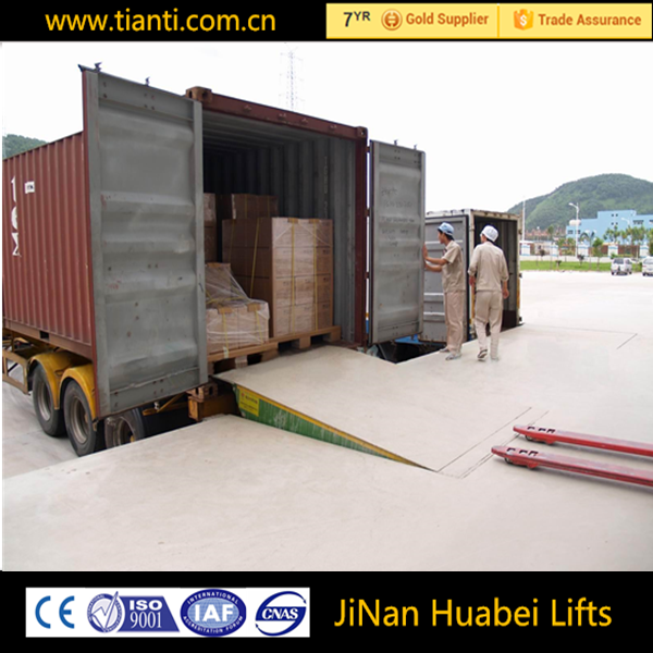 Truck loading and container unloading equipment