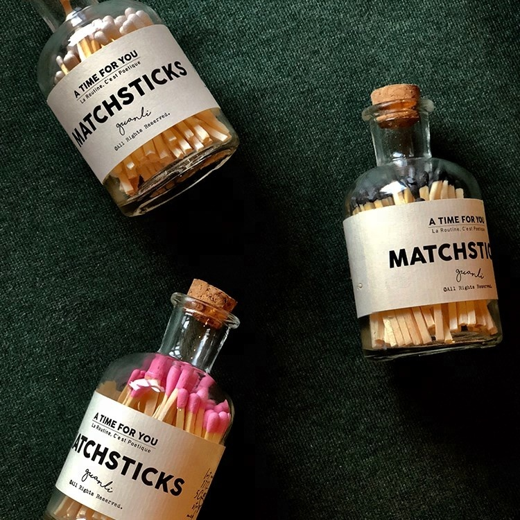 wooden matches in bottle with label
