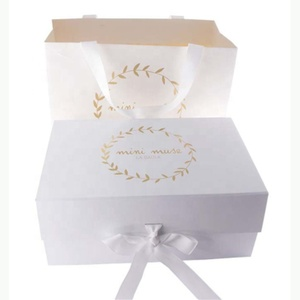 Hard paper gift folding magnetic box for boutique with ribbon bow