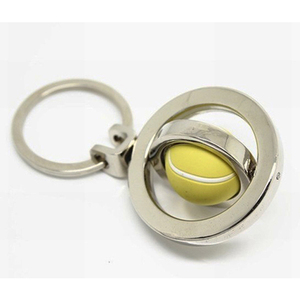 Metal keychain with tennis ball shape