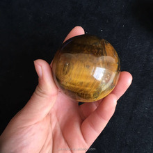 Natural yellow tiger eye crystal sphere for handling