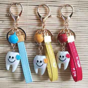 Newest simulation creative smile dental resin material key ring