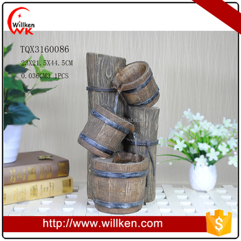 Tree trunk and water bucket polyresin mini water fountain