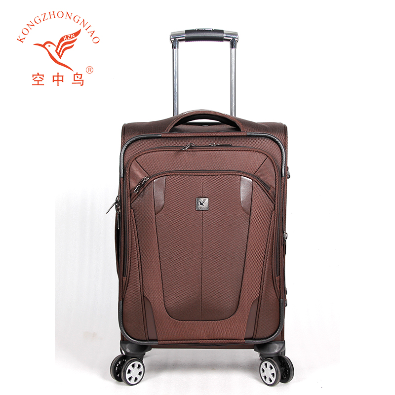 man and woman brown spinner hard travel trolley luggage bags cases