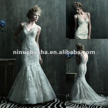 Stunning beaded lace adorns the entire fitted silhouette wedding dress